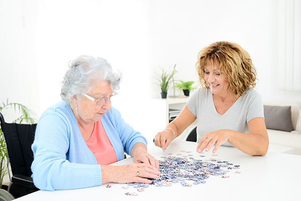 caregiver doing activities with a senior client