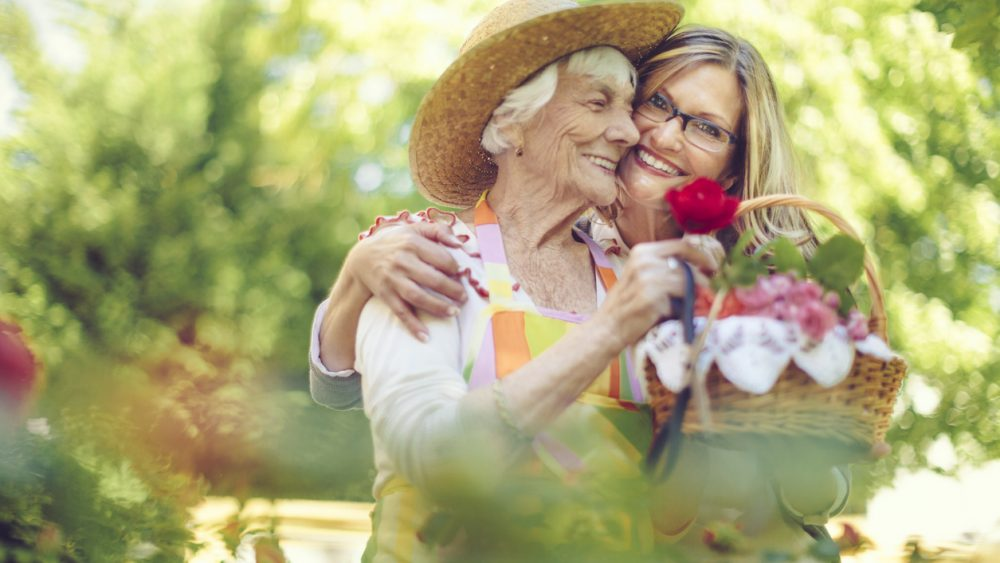 senior care provider helping senior client with activities
