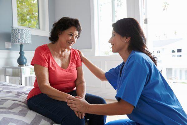 caregiver handing difficult Alzheimer's behavior in senior woman